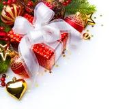 Decoraciones de la Navidad de los rectángulos de regalo de la tarjeta de Navidad Foto de archivo