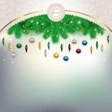 Decoraciones de la Navidad en las ramas debajo del fram modelado Fotos de archivo libres de regalías