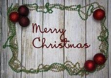 Decoraciones de la Navidad, fondo de madera foto de archivo