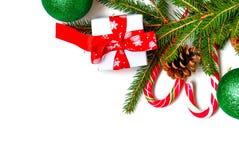 Decoraciones de la Navidad, palillos del caramelo, máscara, topetones en el de madera Fotos de archivo libres de regalías