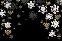 Decoraciones de la Navidad y del Año Nuevo: copos de nieve y corazones de oro imagen de archivo