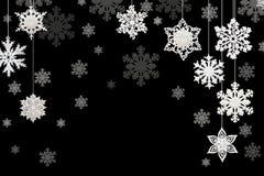 Decoraciones de la Navidad y del Año Nuevo: copos de nieve en backgrou negro fotos de archivo