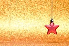 Decoraciones de la Navidad y del Año Nuevo en fondo del brillo Imagenes de archivo