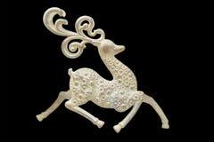 Decoraciones de la Navidad y del Año Nuevo: estatuillas de un ciervo aislante Fotografía de archivo libre de regalías