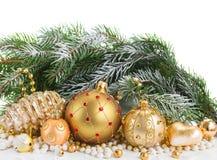 Decoraciones de oro de la Navidad Foto de archivo libre de regalías