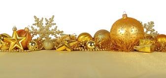 Decoraciones de oro de la Navidad en un blanco Imágenes de archivo libres de regalías