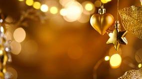 Decoraciones de oro de la Navidad y del Año Nuevo Fondo abstracto del día de fiesta Fotografía de archivo libre de regalías