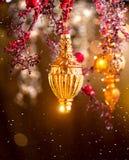 Decoraciones de oro de la Navidad y del Año Nuevo Fondo del día de fiesta del centelleo Fotos de archivo