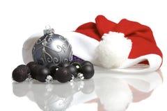 Decoraciones del casquillo de Papá Noel Imagen de archivo libre de regalías
