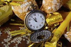 Decoraciones del partido del Año Nuevo del oro Fotografía de archivo libre de regalías
