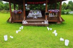 Decoraciones del partido en la tabla en bautismo foto de archivo libre de regalías