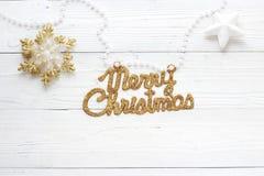 Decoraciones e inscripción del día de fiesta: Feliz Navidad Foto de archivo