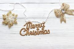 Decoraciones e inscripción del día de fiesta: Feliz Navidad Imagen de archivo libre de regalías