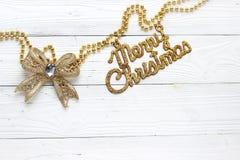 Decoraciones e inscripción del día de fiesta: Feliz Navidad Fotos de archivo
