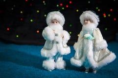 Decoraciones muchacho y muchacha de la Navidad Fotos de archivo libres de regalías