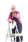 Decorador entusiástico em uma escada Foto de Stock