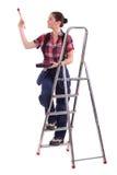 Decorador que sube una escalera foto de archivo libre de regalías