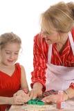 Decorando biscoitos junto foto de stock royalty free
