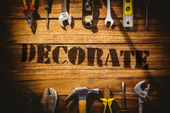 Decorate  against desk with tools Royalty Free Stock Photo
