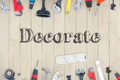 Decorate  against diy tools on wooden background Royalty Free Stock Photo