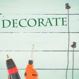 Decorate  against tools on wooden background Royalty Free Stock Photography