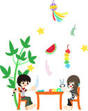 Decorate a bamboo for Festival of the Weaver. A boy and a girl are decorating a bamboo with paper works for a special day Festival of the Weaver Stock Photo