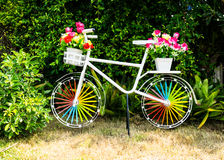 Decorate bicycle with plastic flower. Decorate bicycle with plastic flower in garden Royalty Free Stock Image