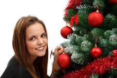 Decorate Christmas tree. Attractive young woman decorates the Christmas tree Stock Photo