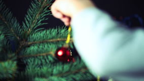 Decorate the Christmas Tree Christmas Toy. Boy Decorates the Christmas Tree Toys. Black Background stock footage