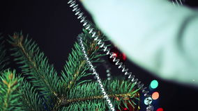 Decorate the Christmas Tree Christmas Toy. Boy Decorates the Christmas Tree Toys. Black Background stock video footage