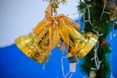 Decorate Christmas tree with double golden bell on Christmas and New Year festival. Royalty Free Stock Photos
