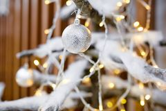 Decorate Christmas tree with toys. Beautiful decorate white Christmas tree with golden sparkling toys Royalty Free Stock Photography