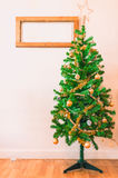 Decorate Christmas tree Stock Images