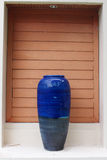 A decorate giant blue vase put on the gate Stock Image