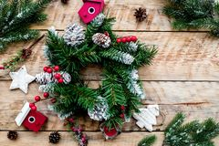 Decorate house for Christmas. Wreath and toys on light wooden background top view copyspace Royalty Free Stock Images