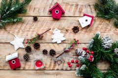 Decorate house for Christmas. Wreath and toys on light wooden background top view Royalty Free Stock Images