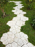 Decorate walkway into the garden with green grass Royalty Free Stock Image