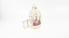 Decorate white metal lantern case with glass of colorful candle Stock Photography