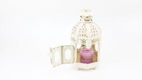 Decorate white metal lantern case with glass of colorful candle Stock Photo