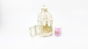 Decorate white metal lantern case with glass of colorful candle Royalty Free Stock Photos