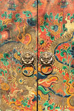 Decorated ancient doors with knockers, Beijing, China. BEIJING-APRIL 14, 2007. Decorated ancient Chinese doors with knockers. Despite a 5000 years old history Royalty Free Stock Images