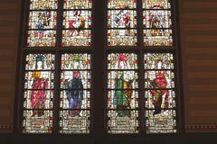 Decorated ancient stained glass windows in the Rijksmuseum, Amsterdam, Netherlands Royalty Free Stock Image