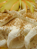 Decorated apple cake. Nice decorated apple cake with cream and apple slices Royalty Free Stock Images