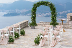 Decorated arch and chairs at the wedding venue. Decorated arch and chairs at the venue of the wedding ceremony Stock Photography