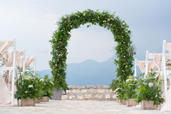 Decorated arch and chairs at the wedding venue. Decorated arch and chairs at the venue of the wedding ceremony Royalty Free Stock Photography