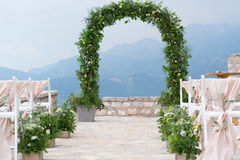 Decorated arch and chairs at the wedding venue. Decorated arch and chairs at the venue of the wedding ceremony Stock Photo
