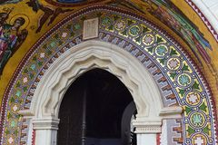 Decorated arch and mosaic over the entrance of the church.  Royalty Free Stock Photo