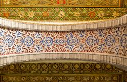 Decorated arch in the Real Alcazar in Seville stock photography