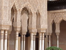 Decorated arches and columns in the Alhambra. Arches and columns carved and decorated inside the Nasrid Palace (Palacio Nazaries), part of the complex of the Stock Photography