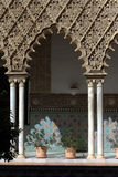 Decorated arches and columns in the Alhambra. Arches and columns carved and decorated inside the Nasrid Palace (Palacio Nazaries), part of the complex of the Stock Image